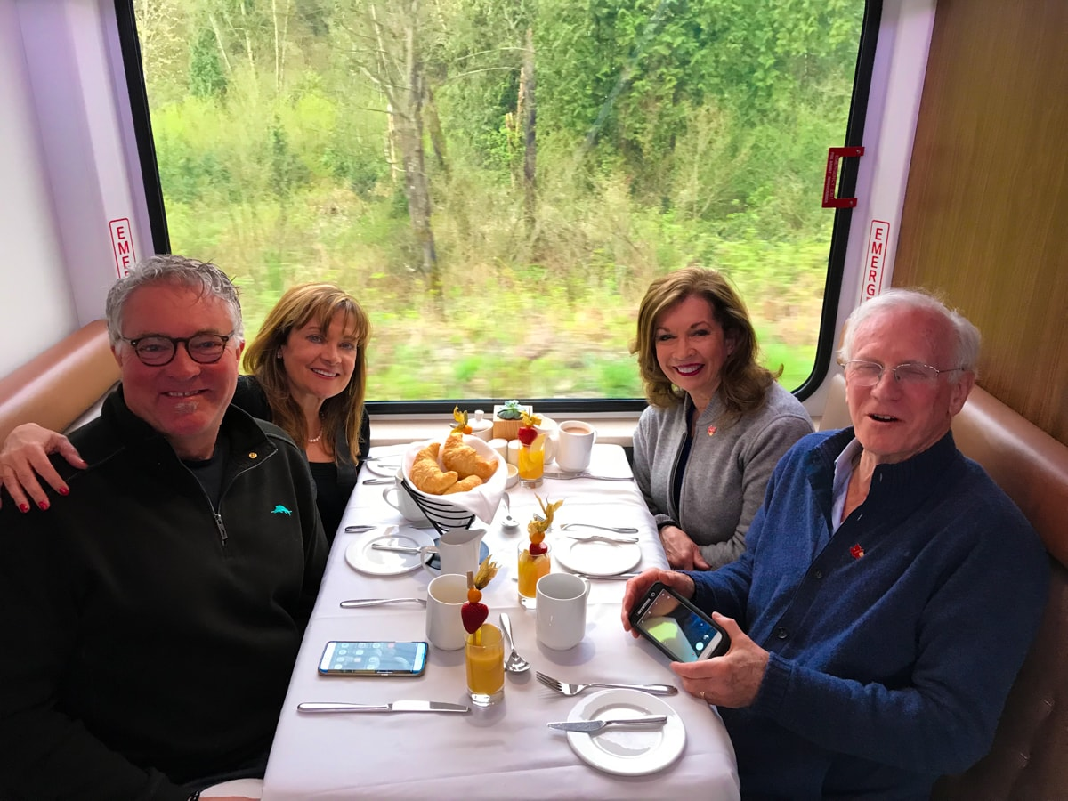 Two couples seated in dining room on Rocky Mountaineer Train.