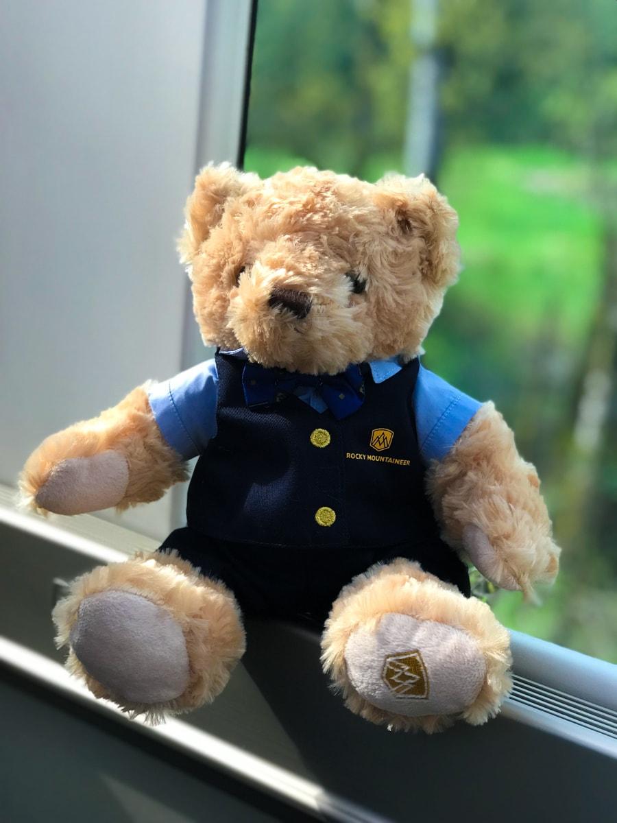 Rocky Mountaineer Train teddy bear in window of train.