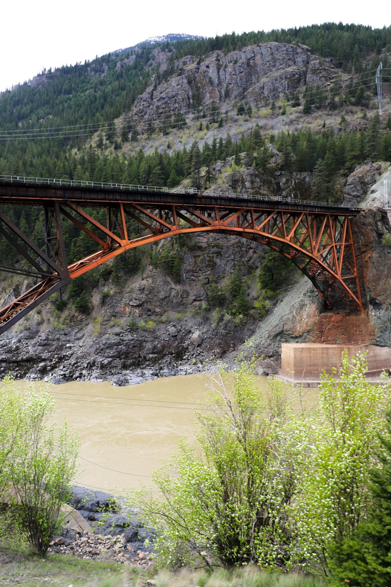View of bridge over river on Rocky Mountaineer Train.