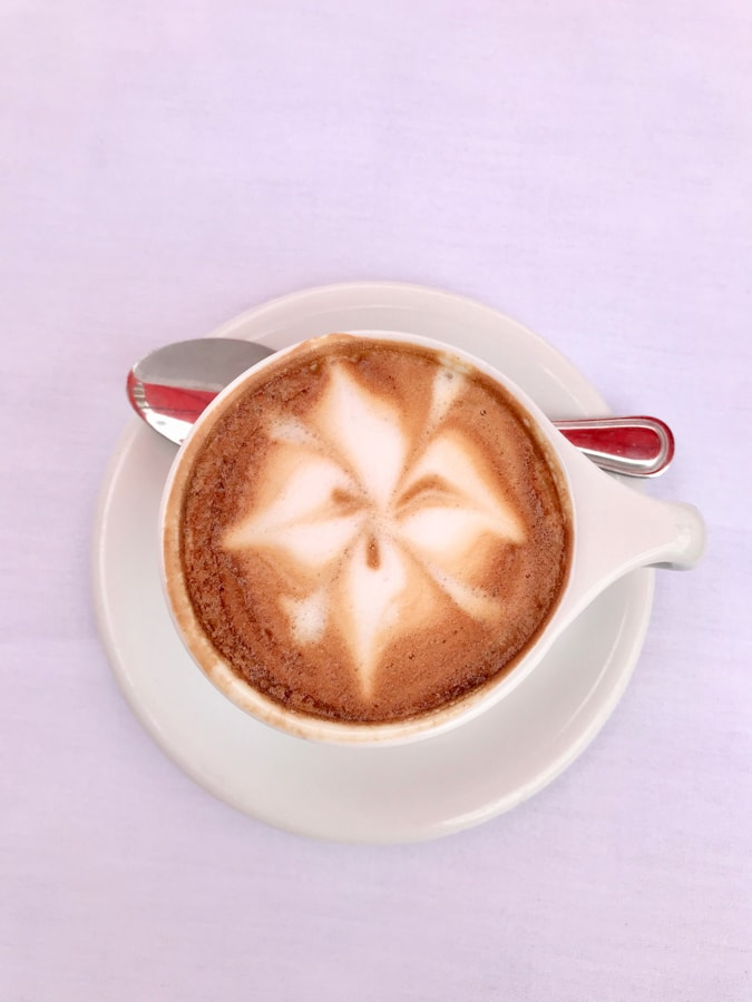 Cappuccino on a pink table.