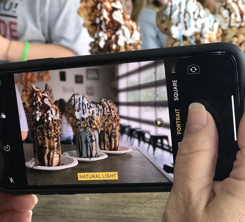 Taking a photo of milkshakes for Instagram.