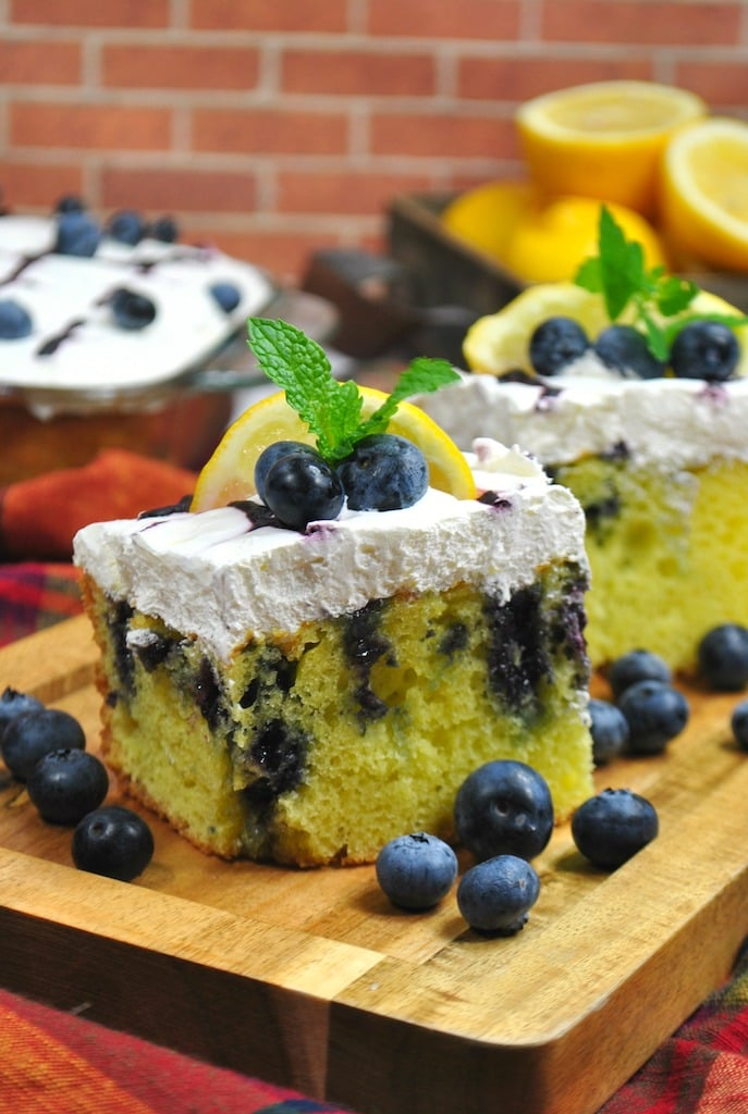 lemon poke cake with blueberries