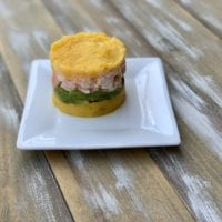 The Shrimp Causa I had on a food tour in Lima Peru last year was incredible. Have you ever eaten Peruvian food? #PeruvianFood #ShrimpRecipes #GAdventures