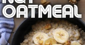 Oatmeal with banana and nuts in a black bowl.