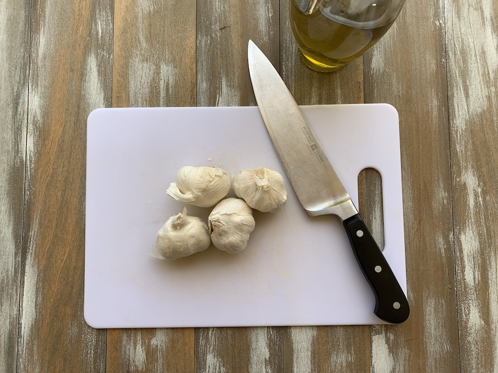 Knowing how to roast garlic cloves is important if you're planning to use roasted garlic in a dish or as a side with bread. Roasted garlic is creamy and delicious, and spreads like butter once it's roasted.
