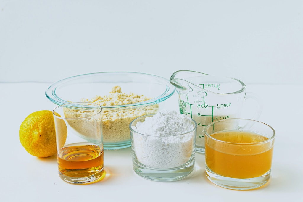 ingredients for amaretti cookies in glass containers