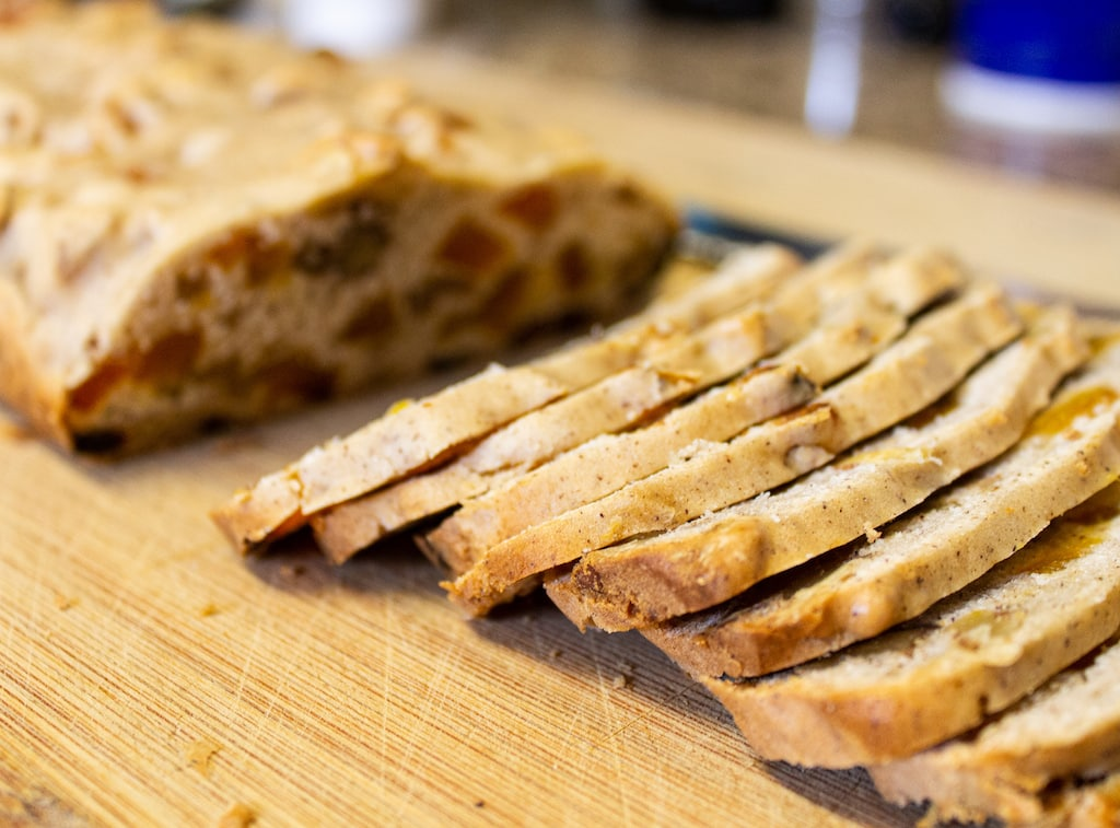 cutting biscotti on cutting board