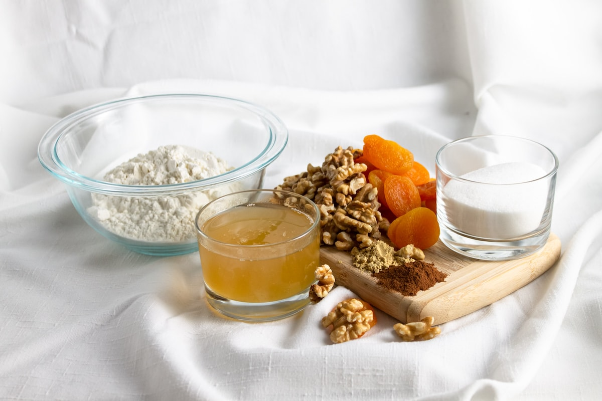 ingredients for Apricot biscotti on a white cloth