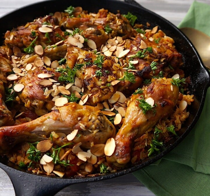 chicken in cast iron skillet with rice
