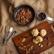 chocolate chip pecan cookies on a wood board