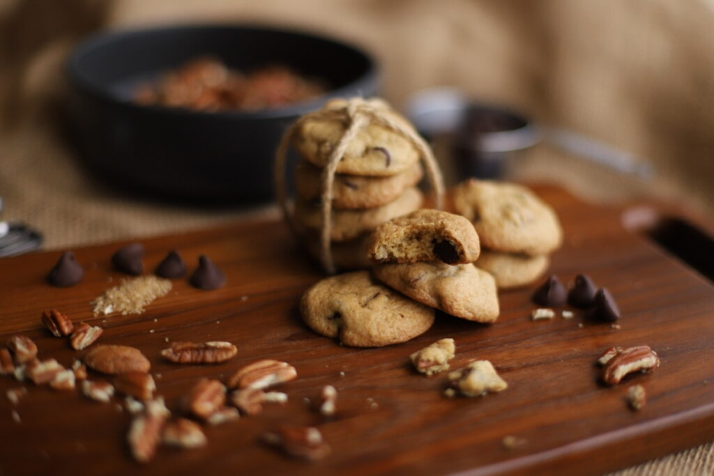 chocolate chip pecan cookies on wood board