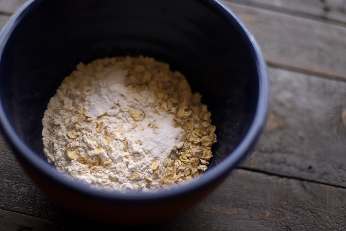 oatmeal cookie dry mix in blue bowl on wood table