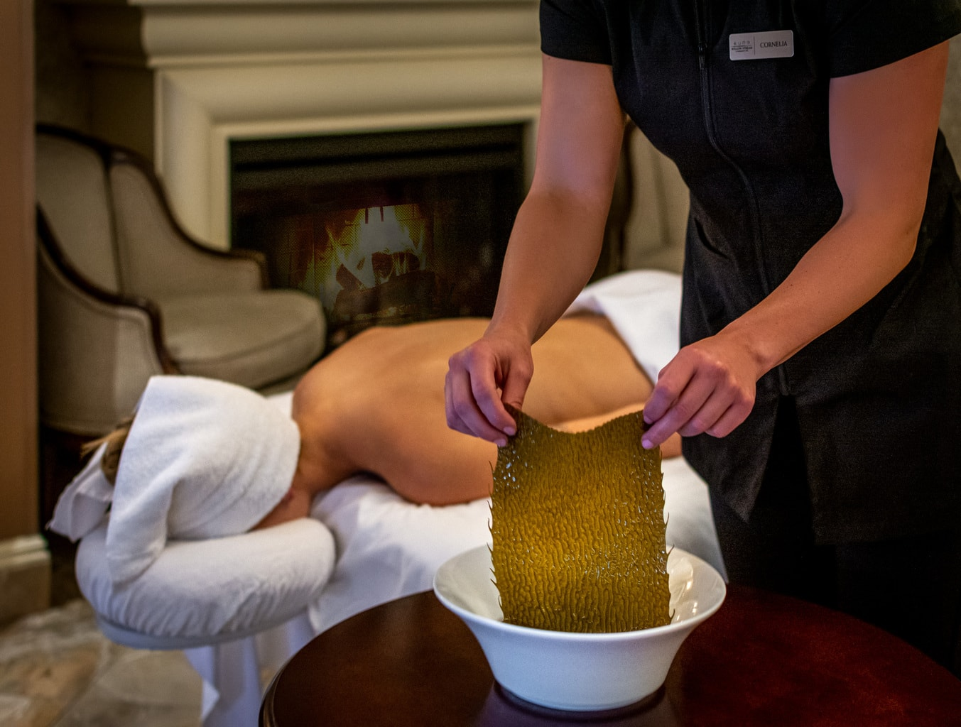 woman getting a seaweed treatment massage at one of the top Canada spas