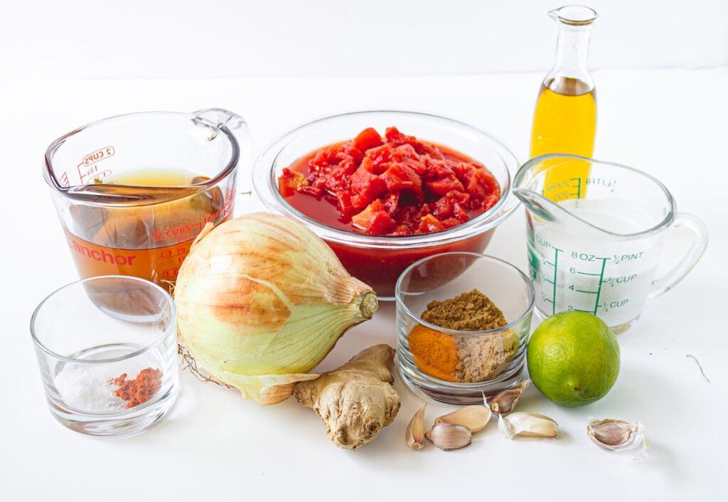 vegetable broth, tomatoes, oil, line, seasoning, coconut milk, ginger, garlic