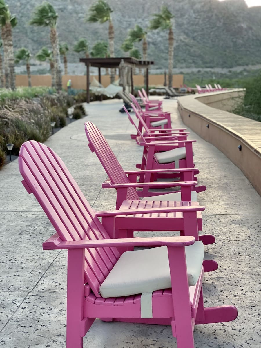 pink chairs facing beach