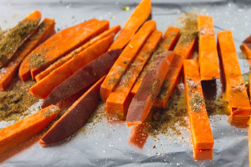 sweet potatoes slices on baking sheet