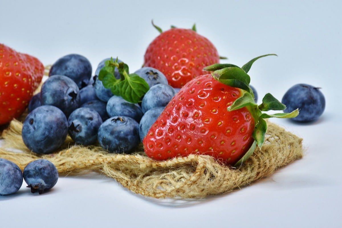 strawberries and blueberries on burlap