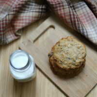 oatmeal raisin cookies with honey on cutting board