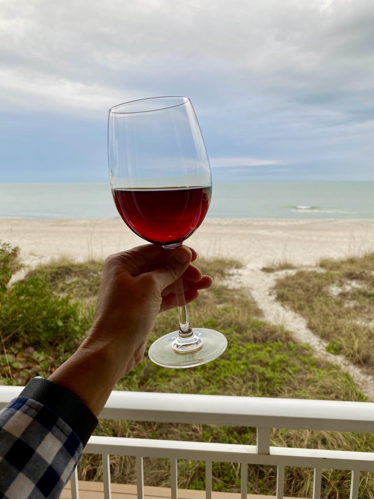 Toasting with wine on the balcony at Mainsail Beach Inn.