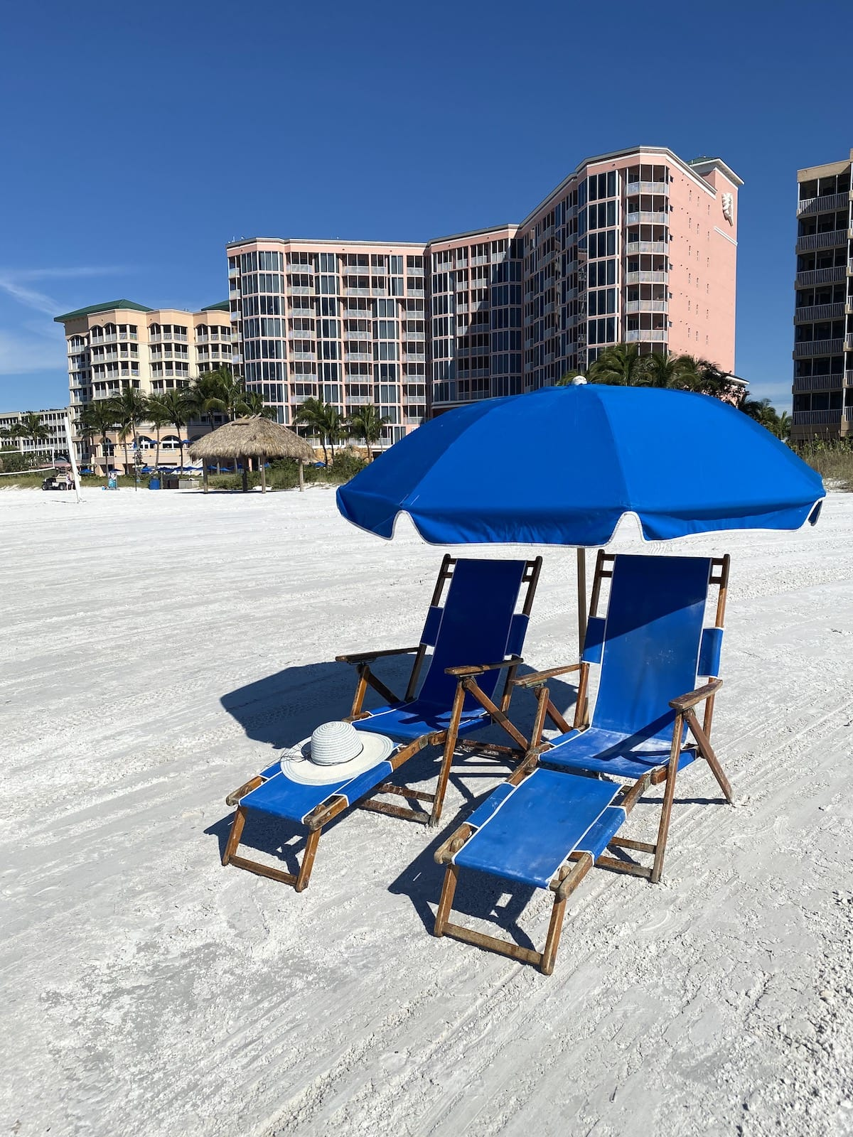 chairs on beach at Pink Shell Beach Resort & Marina