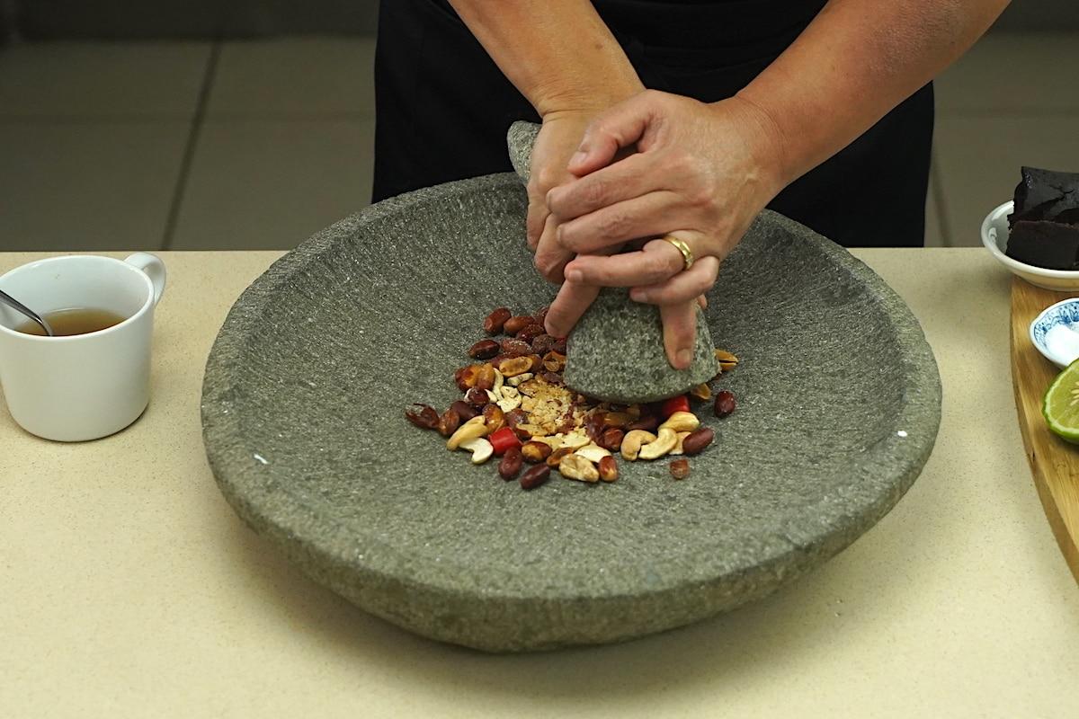 Grinding nuts for Gado Gado recipe.