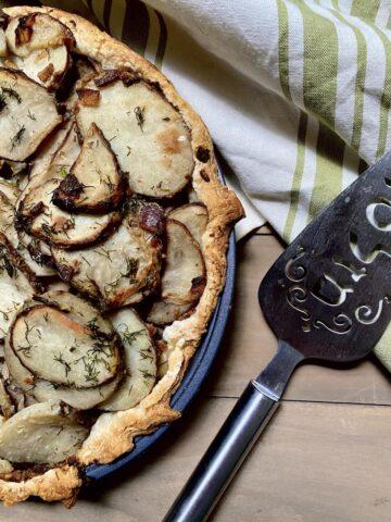 Irish Potato Pie in pan with pie spatula.