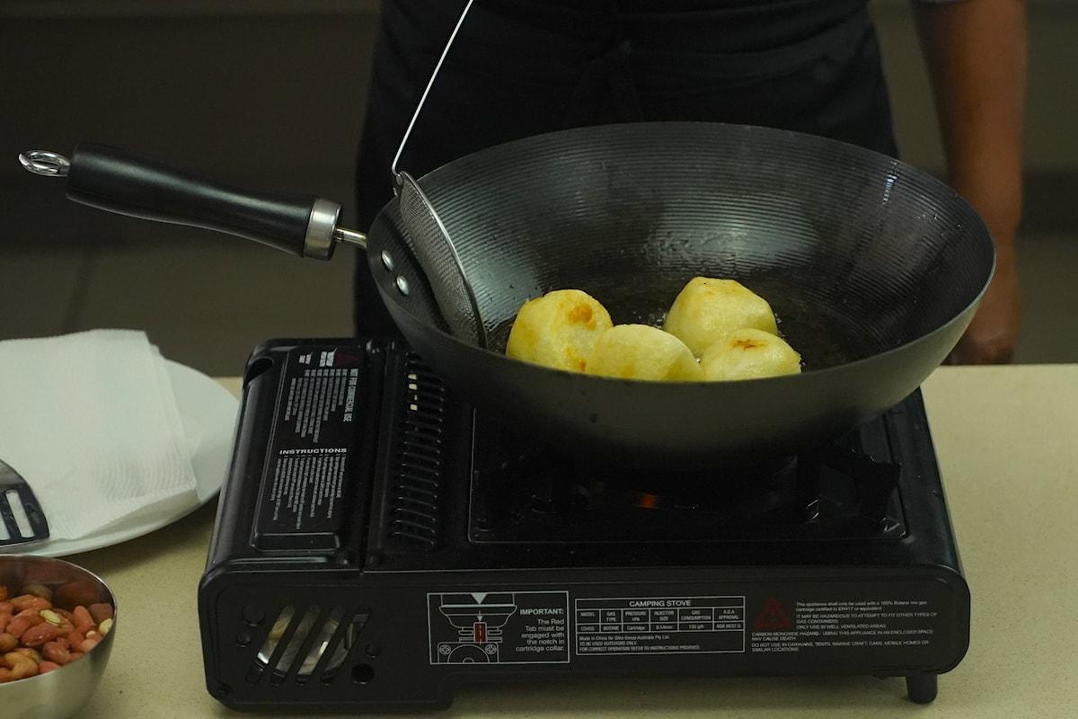 Cooking potatoes for Gado Gado recipe.
