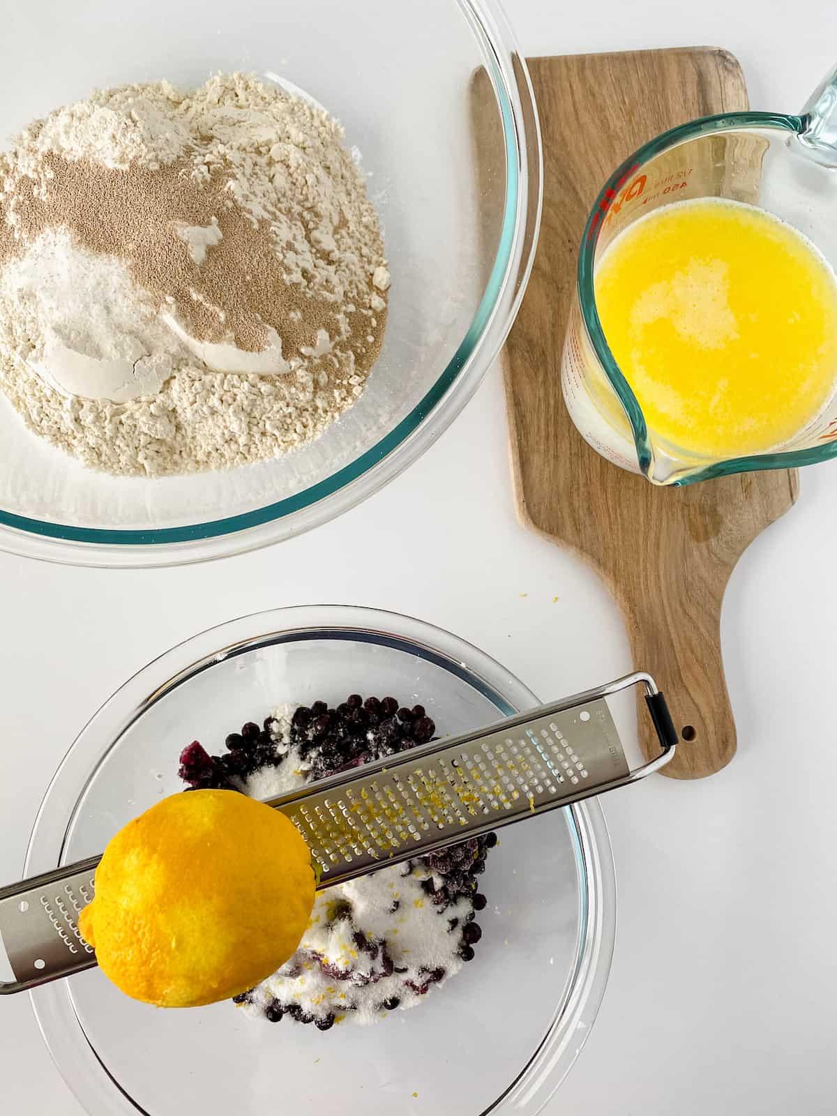 Lemon zest for blueberry sweet buns.