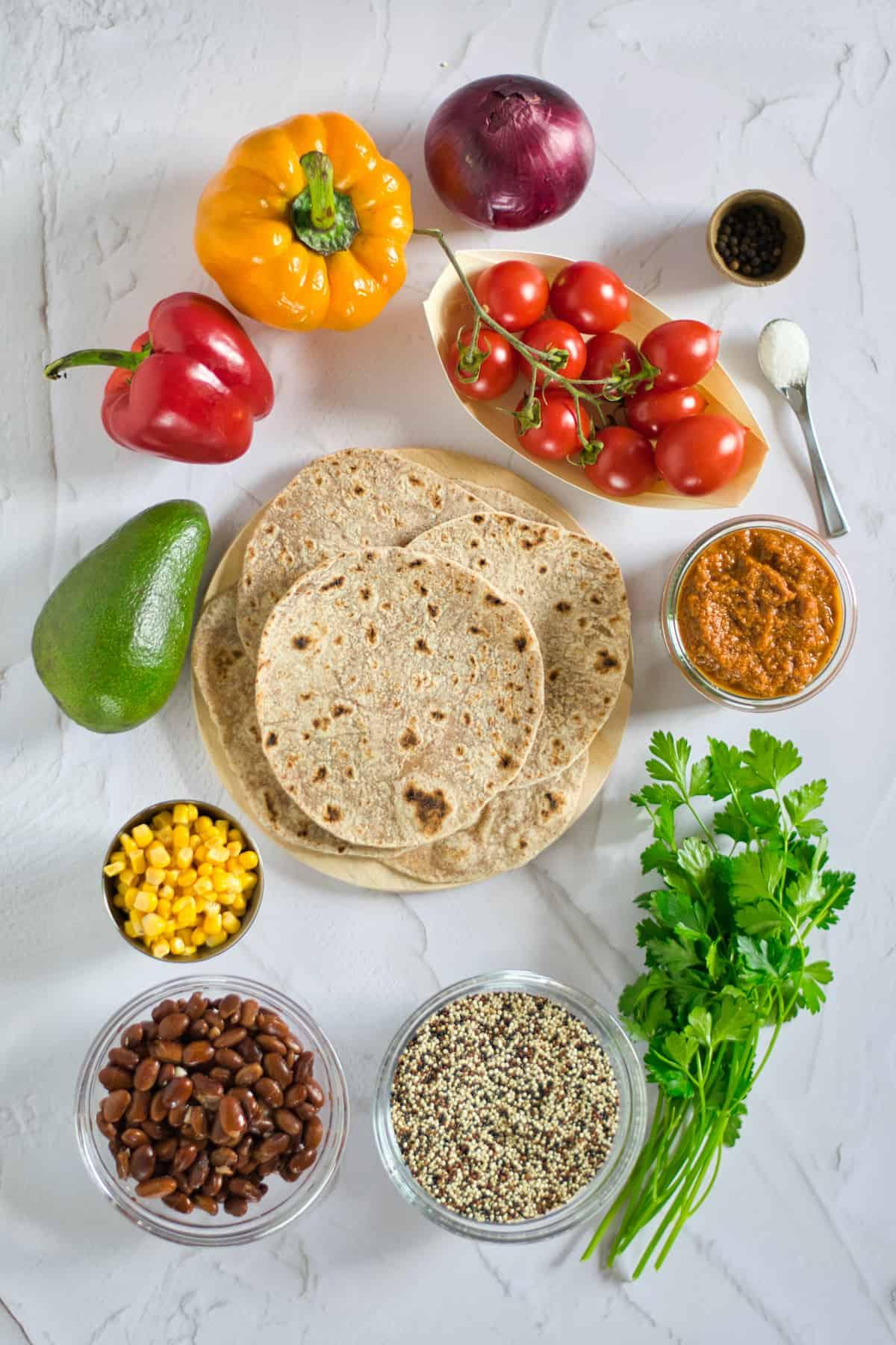 Quinoa, beans, corn, cilantro, tortillas, avocado, peppers, tomatoes, salsa, onion for Quinoa Tacos.