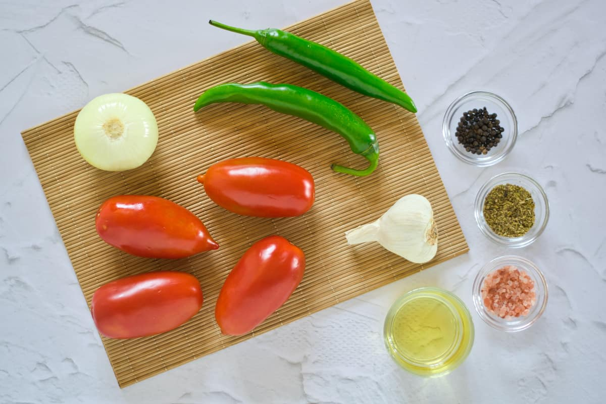 Ingredients for salsa on bamboo mat.
