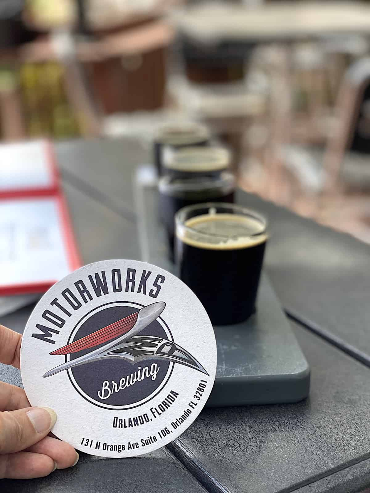 Motorworks coaster in front of a beer flight.