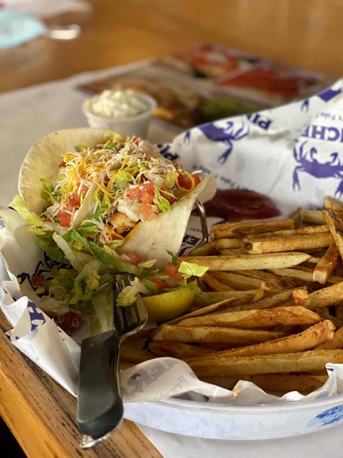 Fish tacos and French fries in a basket at Pinchers.