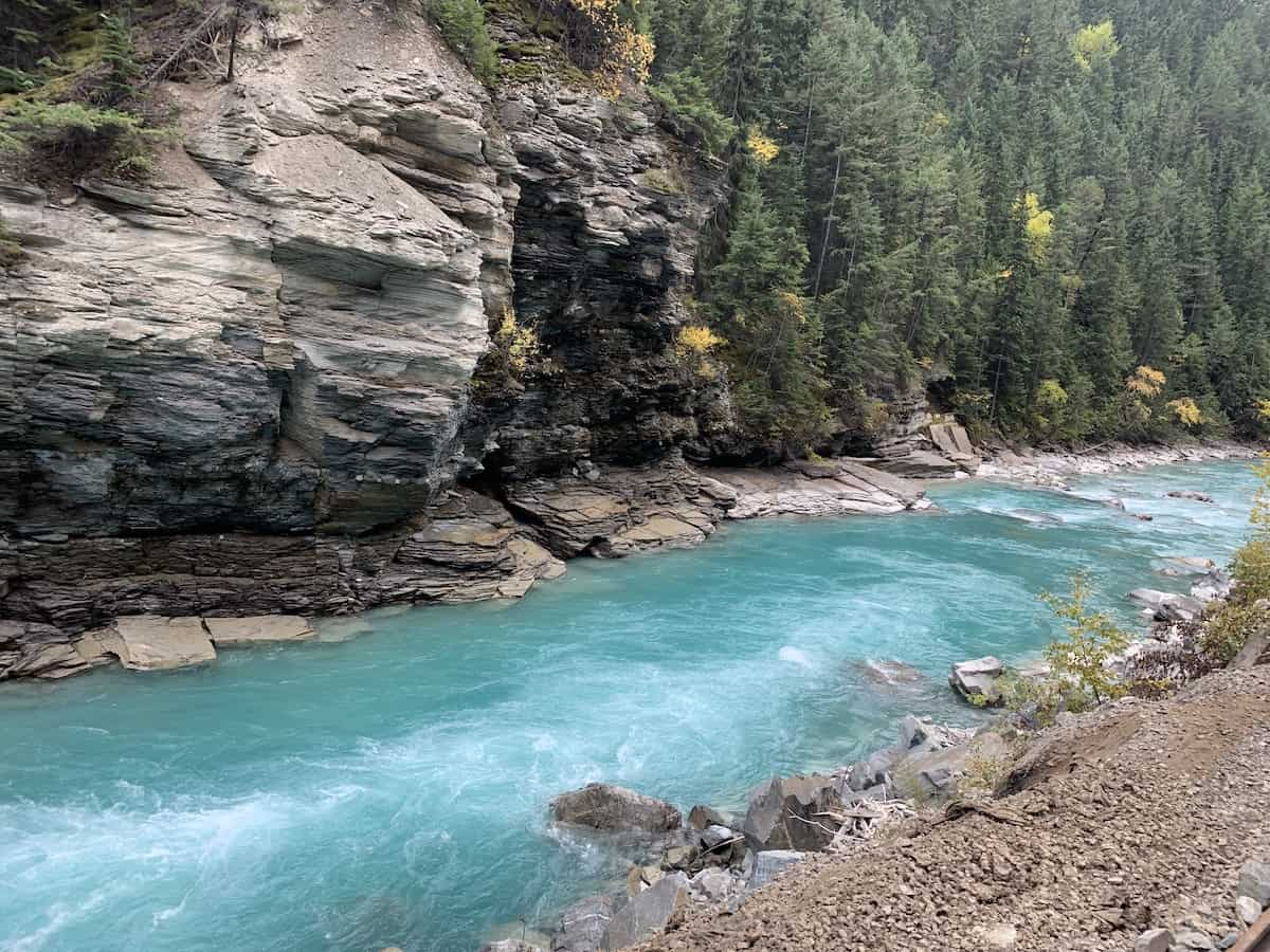 Blue river with mountain in background in Canada.