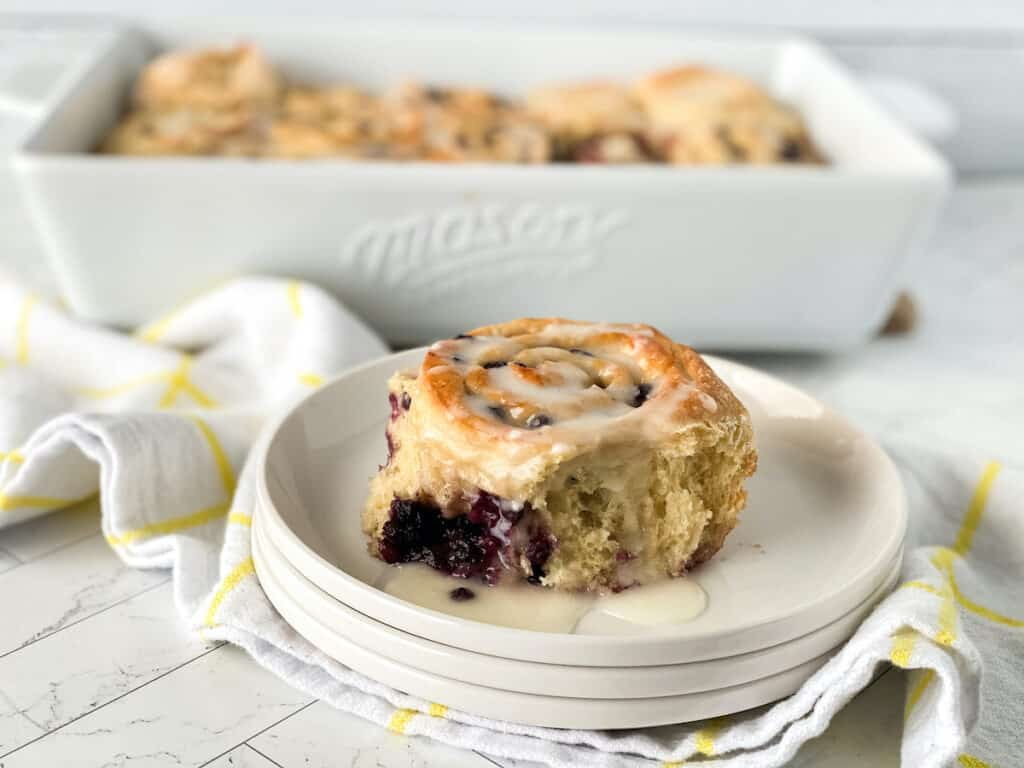 Breakfast bun with blueberries and icing.