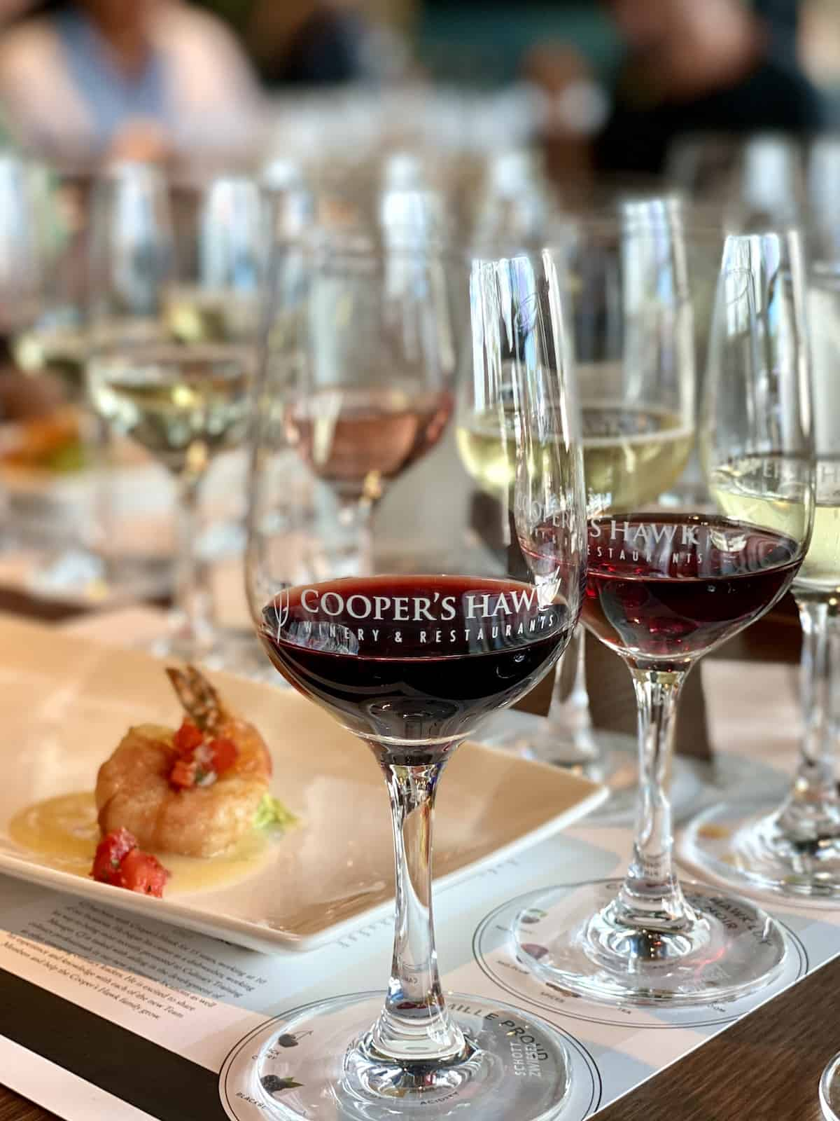 Wine glasses and shrimp appetizer at Cooper's Hawk Winery