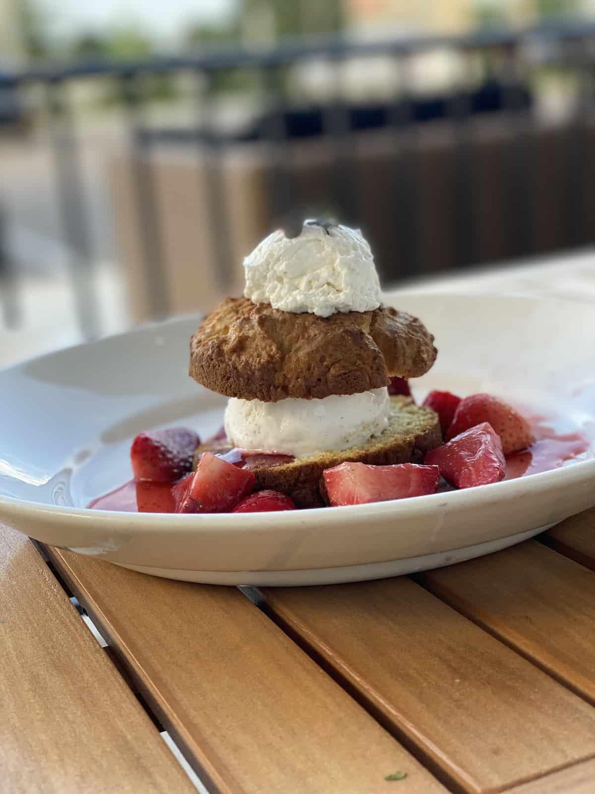 Strawberry shortcake with shipped cream.