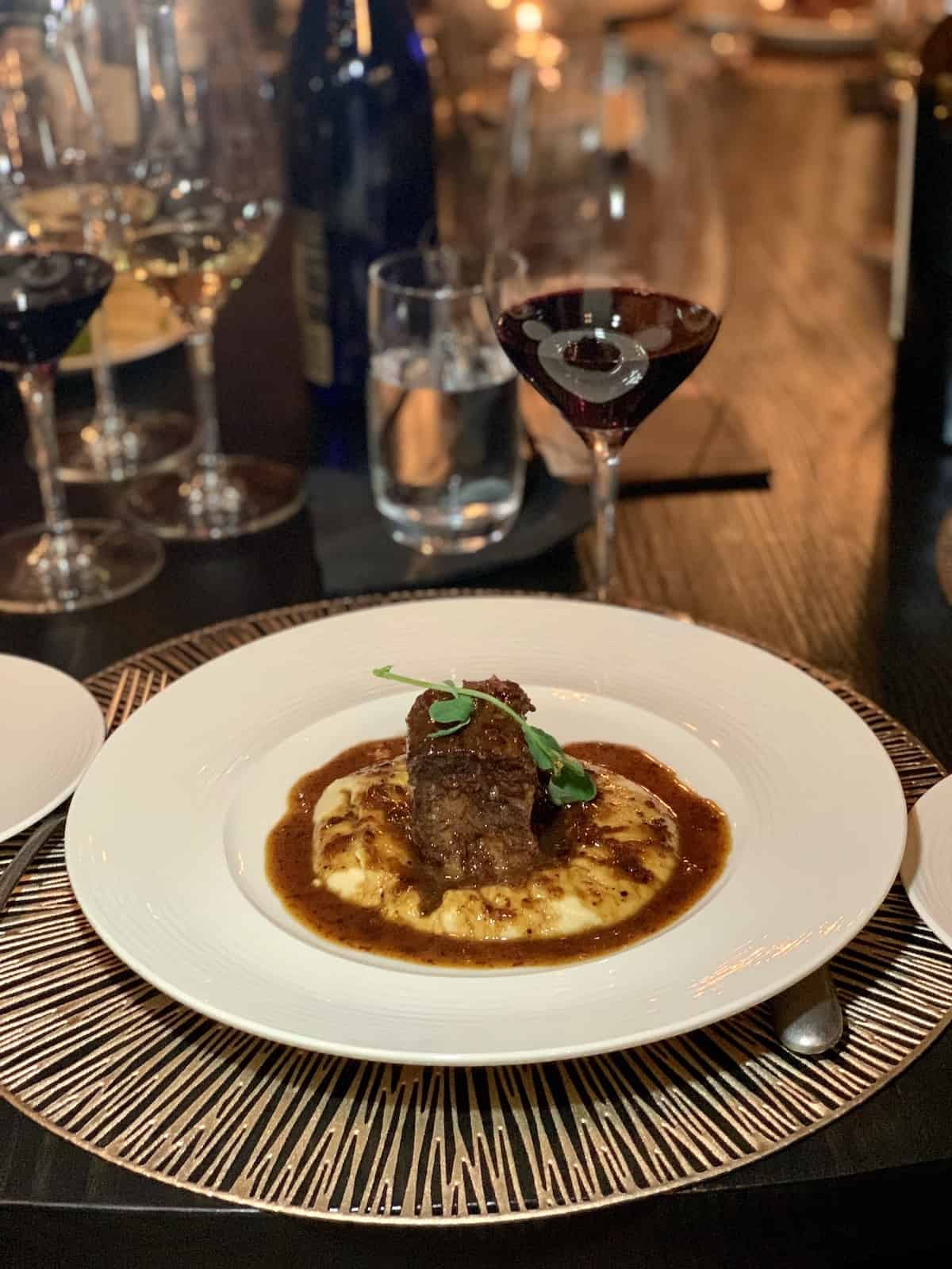 Short rib over mashed potatoes with gravy.
