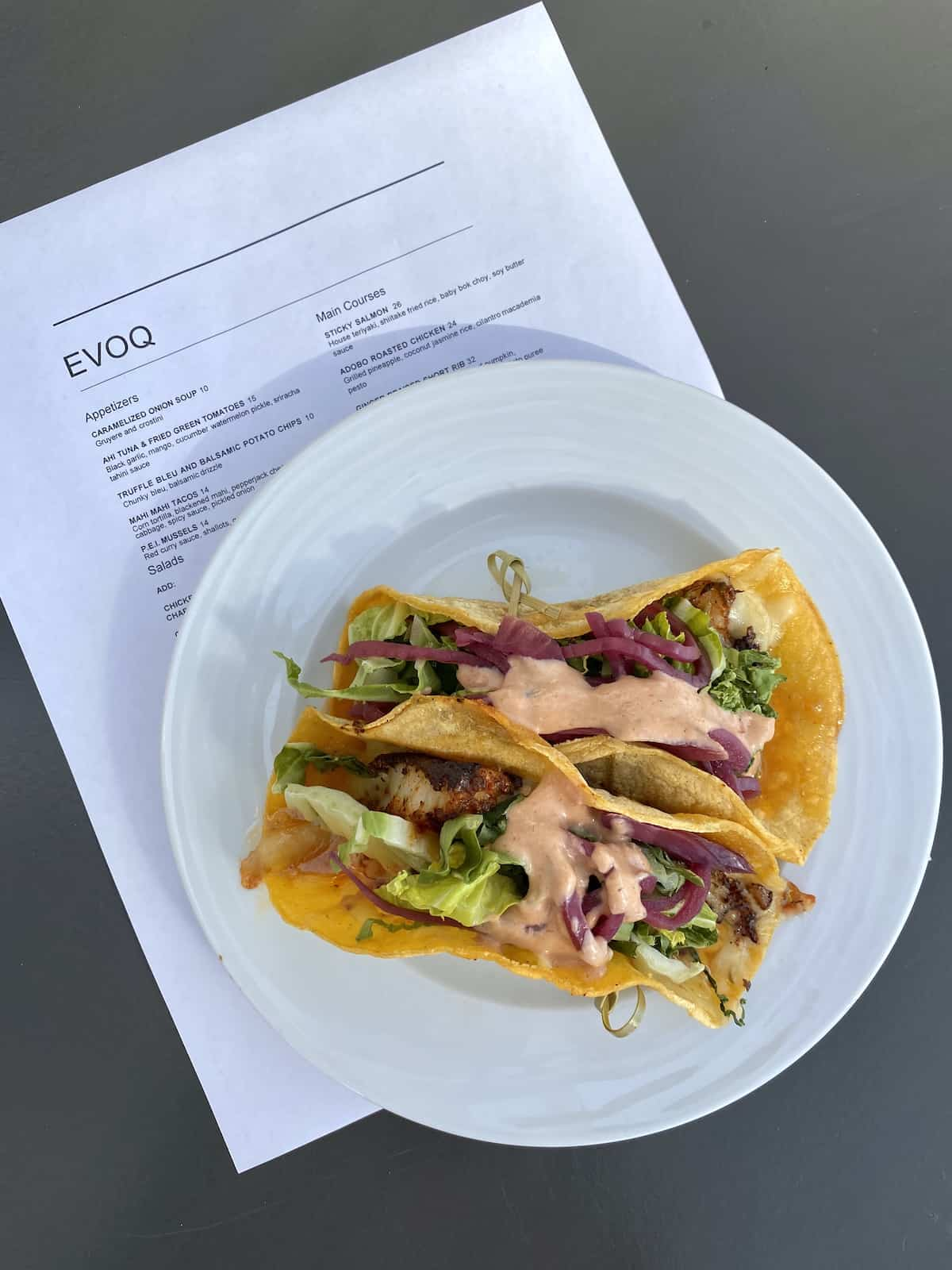 Fish tacos with spicy sauce at Evoq restaurant in Sarasota
